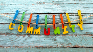 Letters of community held up on a line with pegs